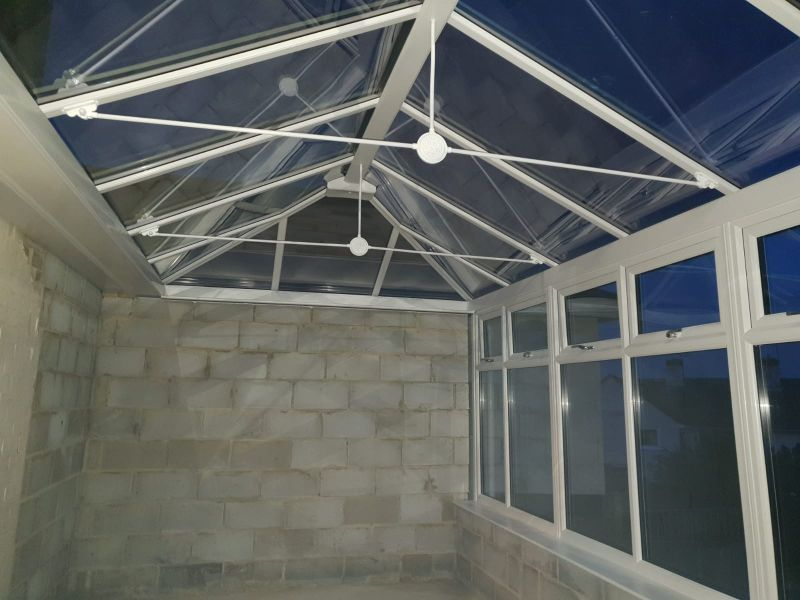 By choosing to entirely block the far end of the conservatory, Mrs G will be able to enjoy privacy